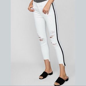 White distressed jeans with black stripe
